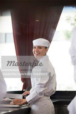 Chef chopping in restaurant kitchen