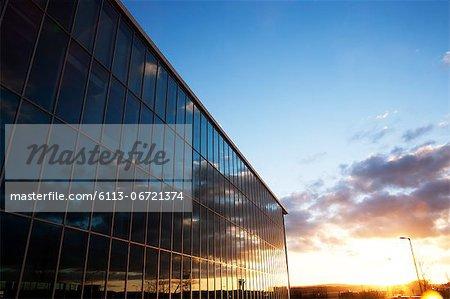 Sunrise sky reflected in modern building windows