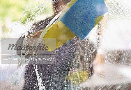 Man washing window with sponge