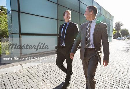 Businessmen talking on city street