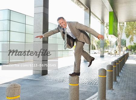Businessman playing on city street