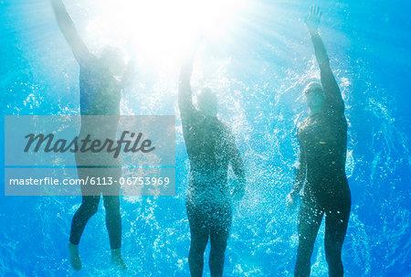 Athletes swimming underwater