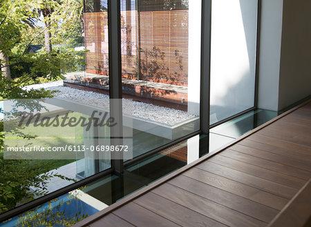 Footpath along window of modern house