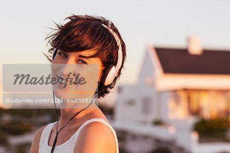 Portrait of smiling woman wearing headphones