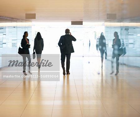 Business people walking in lobby