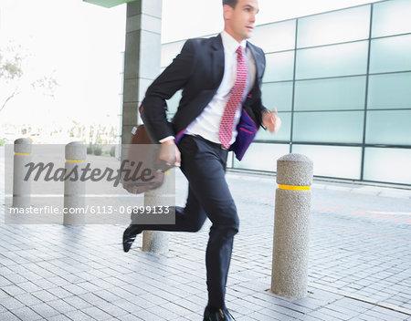 Businessman with briefcase running