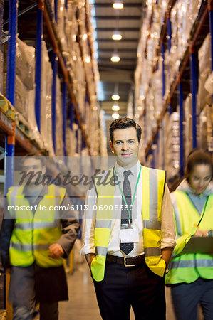 Worker standing in warehouse