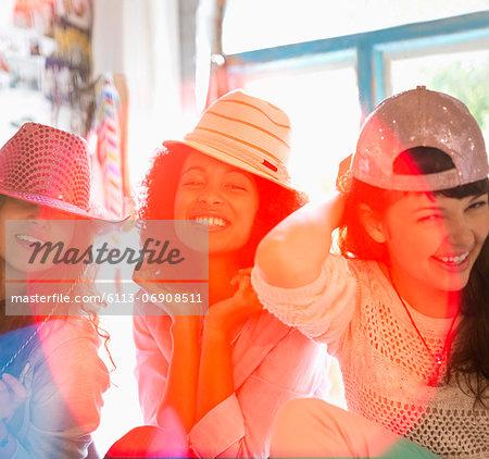 Women wearing hats in bedroom