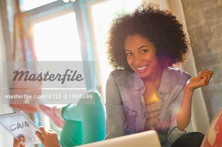 Woman smiling in bedroom