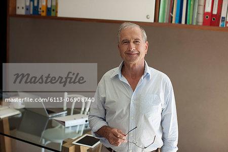 Older man smiling in office