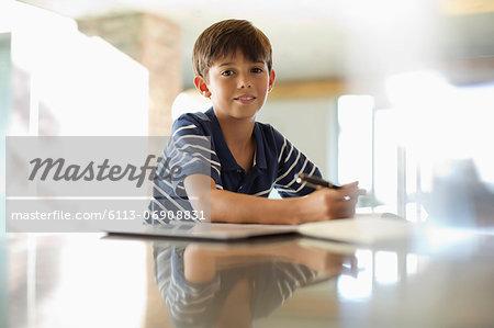 Boy doing homework at counter