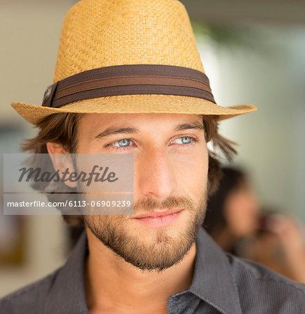 Smiling man wearing straw hat