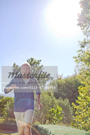 Senior man running in park