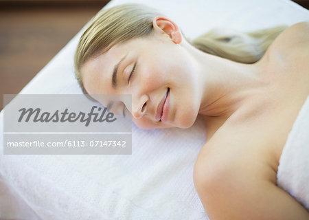 Serene woman laying on massage table