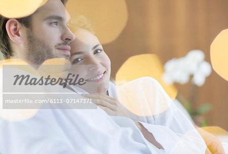 Couple hugging in bathrobes