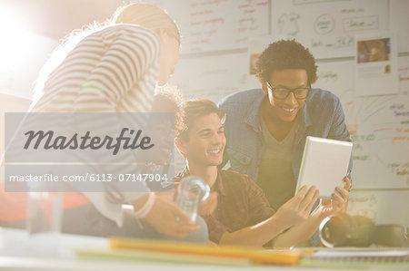 Business people using digital tablet in meeting