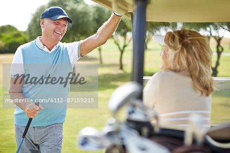 Senior couple in golf cart