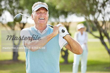 Senior couple on golf course