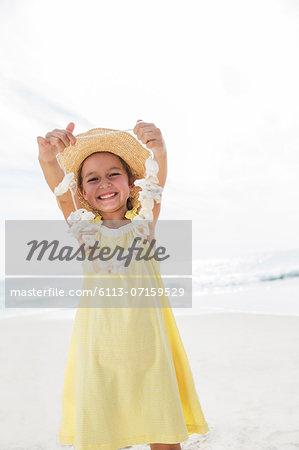 Girl playing with seashells on beach