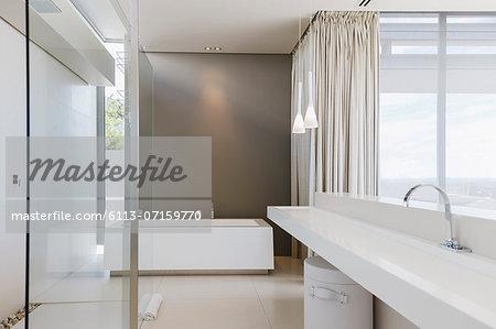 Sink and bathtub in modern bathroom