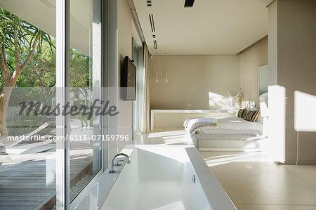 Bathtub in modern master bedroom
