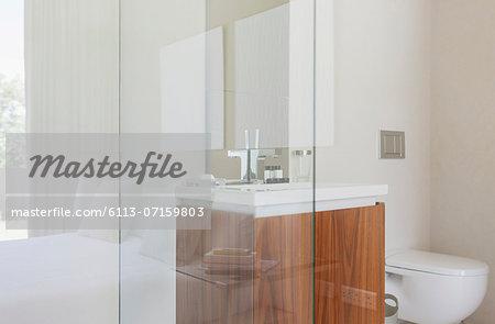Glass walls of modern bathroom