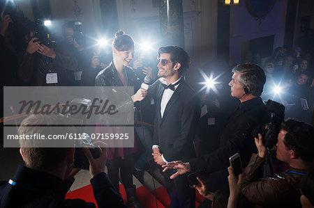 Celebrity being interviewed on red carpet
