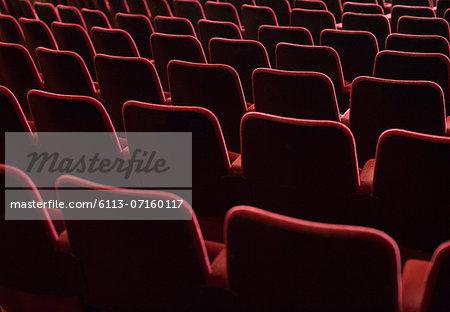 Seats in empty theater auditorium