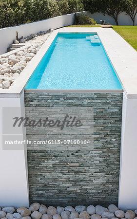 Stone wall of modern lap pool