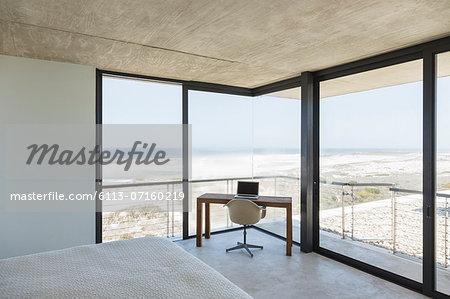 Desk in modern bedroom overlooking ocean