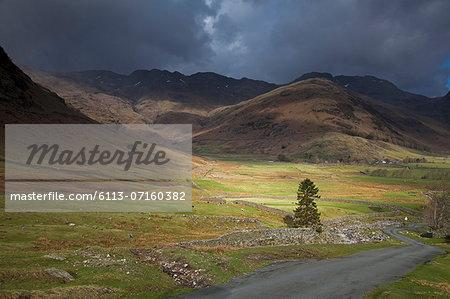 Storm clouds over rural hills
