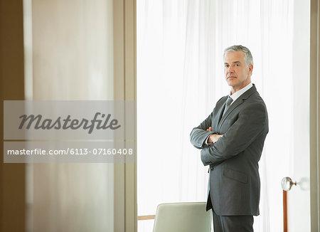Businessman standing in doorway