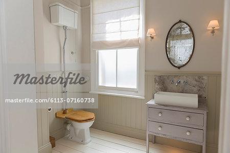 Toilet and sink in ornate bathroom