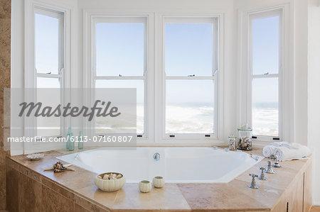 Jacuzzi tub in bathroom overlooking ocean
