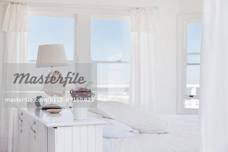 Shell lamp in bedroom overlooking ocean