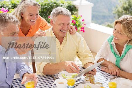 Older couples using digital tablet