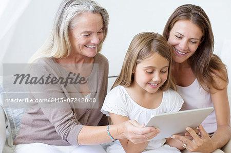Multi-generation women using digital tablet