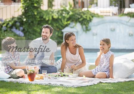 Family enjoying picnic in grass