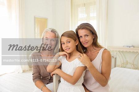 Multi-generation women in bedroom
