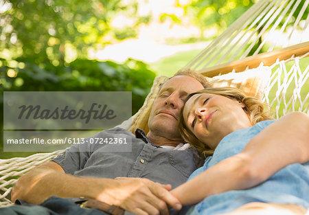 Couple sleeping in hammock