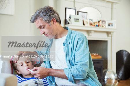 Father checking son's temperature
