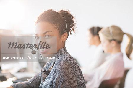 Businesswoman wearing headset in office