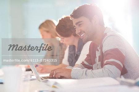University student using laptop in classroom