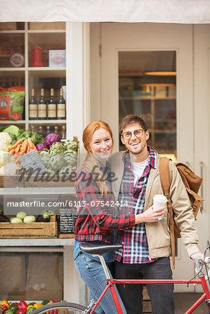 Couple hugging on city street