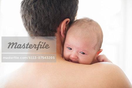 Man comforting crying baby girl
