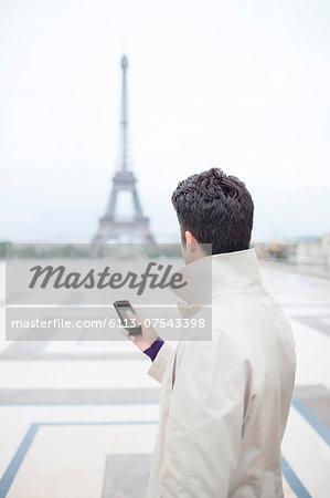Businessman admiring Eiffel Tower, Paris, France