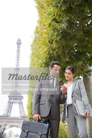 Business people talking near Eiffel Tower, Paris, France