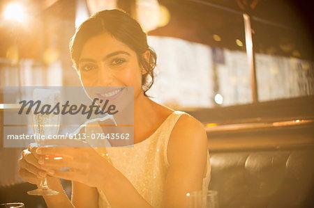 Woman having champagne in restaurant