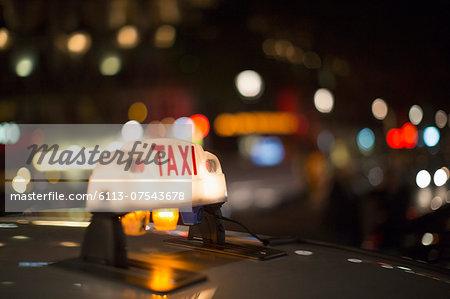 Close up of illuminated Parisian taxi light, Paris, France