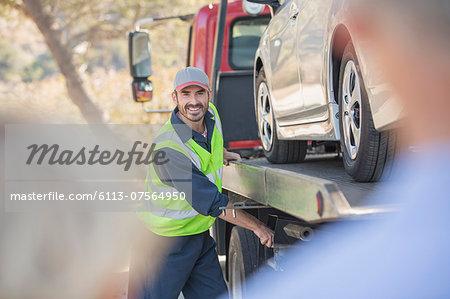 Roadside mechanic towing car for senior couple